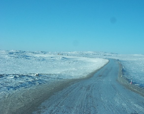 Off Road Trucking over the frozen tundra on the ice roads of the Northwest Territories.