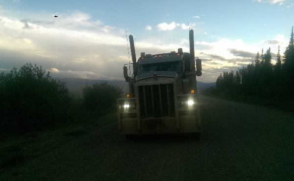 Dimming high beams and driving lights is a serious issue in the oil and gas industry when off road trucking on narrow and dangerous roads.