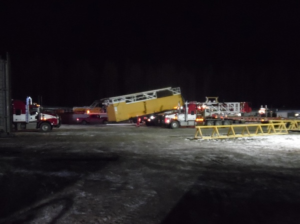 Oilfield Photos. Rig movers doing a night move of a drilling rig