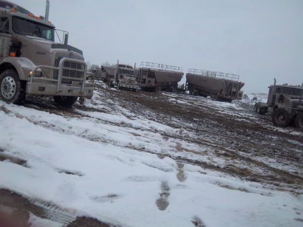 Frac Hauling on a muddy snowy location
