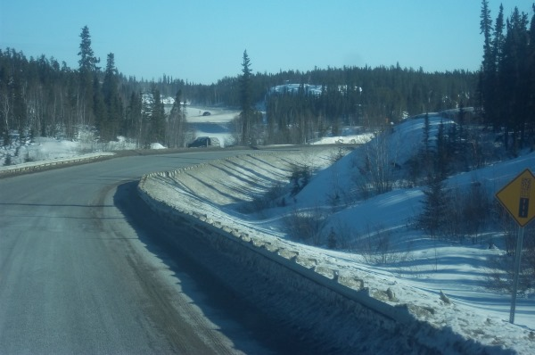 Ice Road Trucking e-book preview 8. The narrow twisting curves of the Ingraham trail heading north to the start of the ice road.