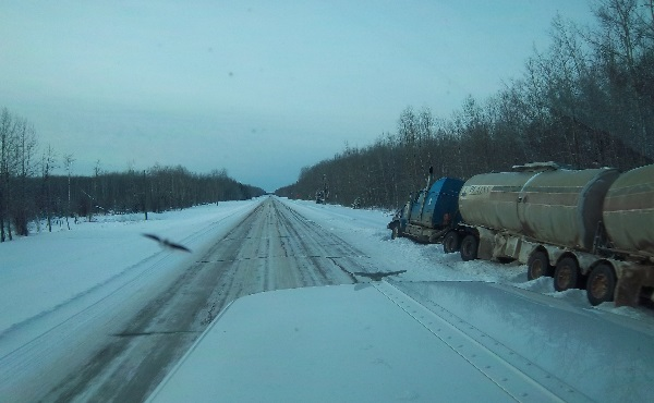 Oilfield Accidents. Crude Oil hauler in the ditch