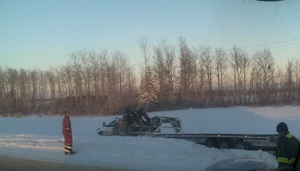 Oilfield Accidents. 1 ton truck and gooseneck trailer in need of a tug