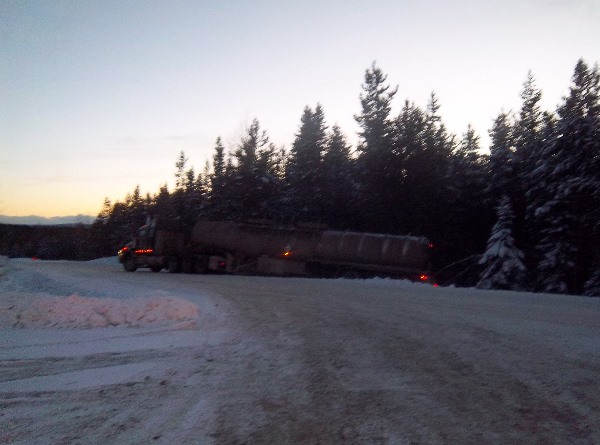 Oilfield Accidents - A tanker truck slides of the Block 60 road in icy conditions