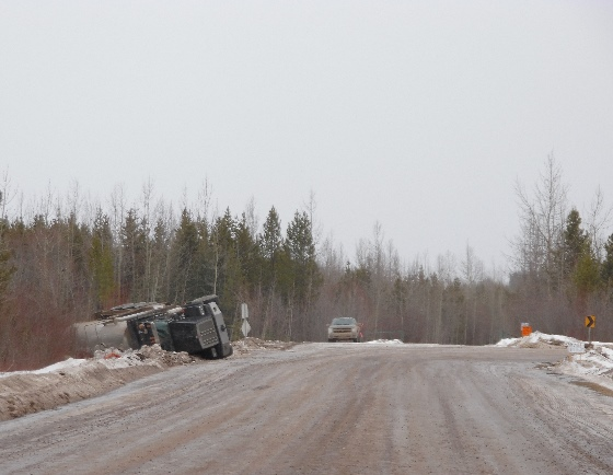 Oilfield accidents - A body job rolls onto its side on an icy Weyerhauser rd. corner