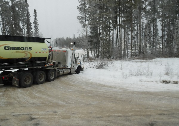 Oilfield Accidents. Tri-drive trucks are challenging on icy corners