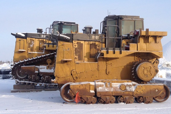 Ice Road Loads. 2 D-10 dozers waiting to travel up the ice road