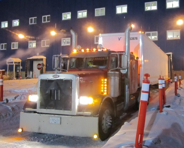 Ice Road Loads. Unloading at a loading dock at the diamond mine