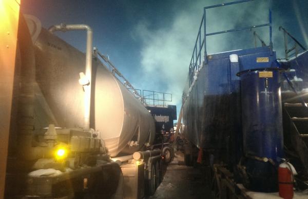 Frac Hauling. Unloading frac sand