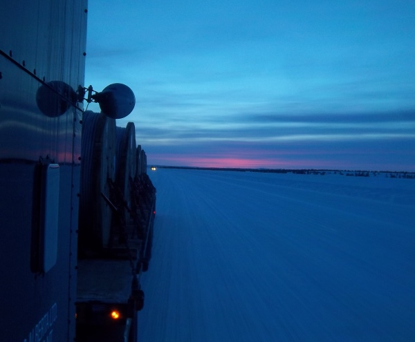 Ice Road Loads. Heading up the ice road at dusk