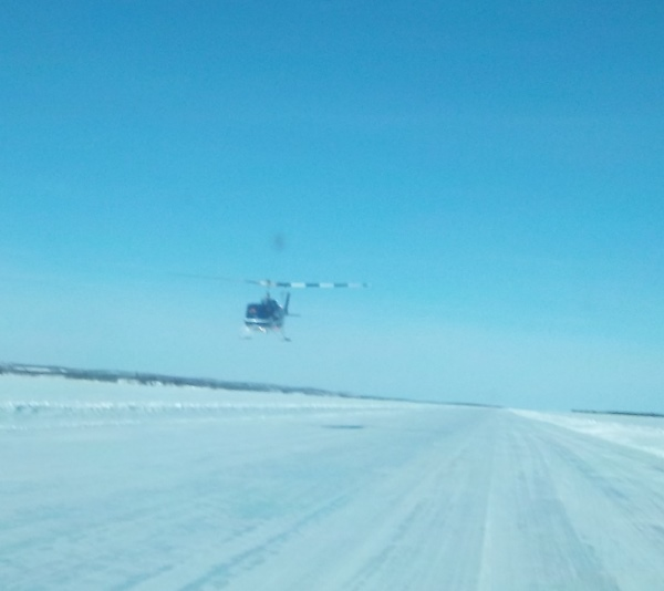 Ice Road Driving Photos. Low flying chopper on Gordon Lake.