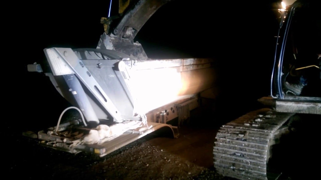 Truck driving videos. Dropped trailer sinks into the ground