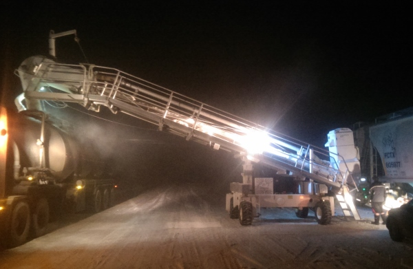 Frac hauling. loading frac sand from rail cars at night