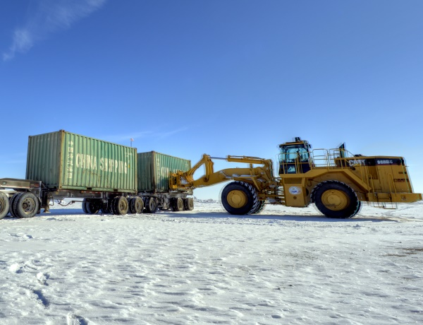 Ice Road Loads. Offloading containers at the diamond mine