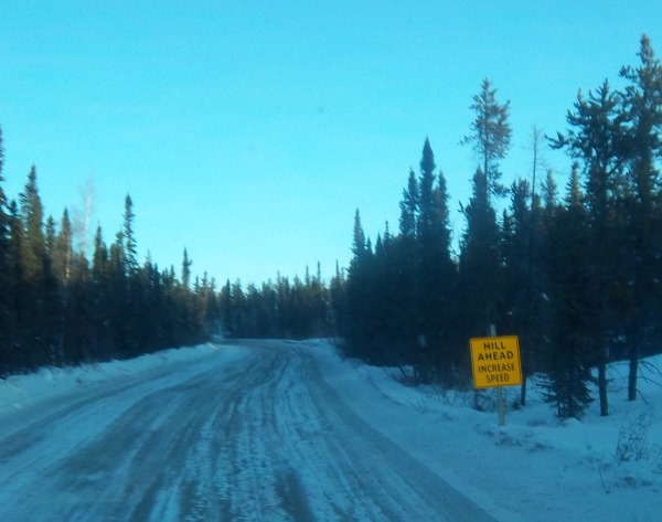 Ice Road Driving Photos. Warning sign ice road portage