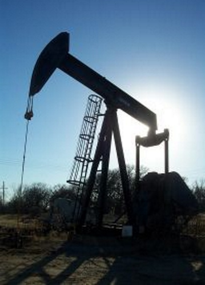 Oilfield Photos. Pump jack casting shadow in the sun