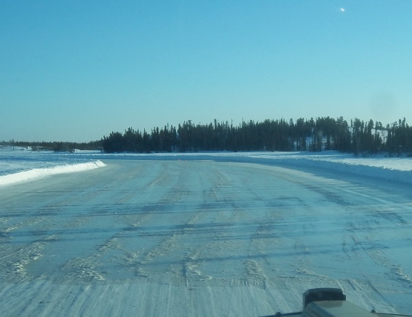 Ice Road Driving Photos. Flooding to repair cracks and build thickness