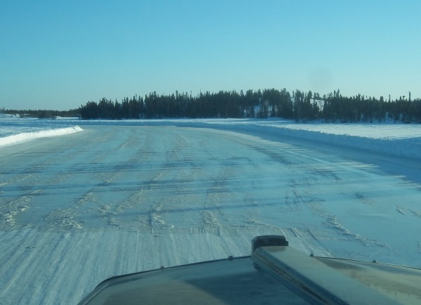 Tibbett Contwoyto WinterRoad. Freshly flooded ice becomes slushy and rough from truck traffic and has to smoothed with a grader blade