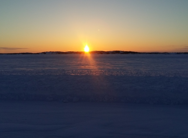 Sunrises, sunsets, sun dogs, Northern Lights and skies. Setting sun on Gordon Lake Northwest Territories.