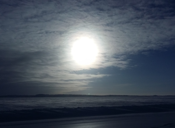 Sunrises, sunsets, sun dogs, Northern Lights and skies. The mid day sun makes its presence known in far north of Canada.