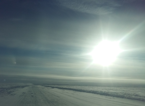 Sunrises, sunsets, sun dogs, Northern Lights and skies. Above the tree line on the frozen tundra in Northern Canada,