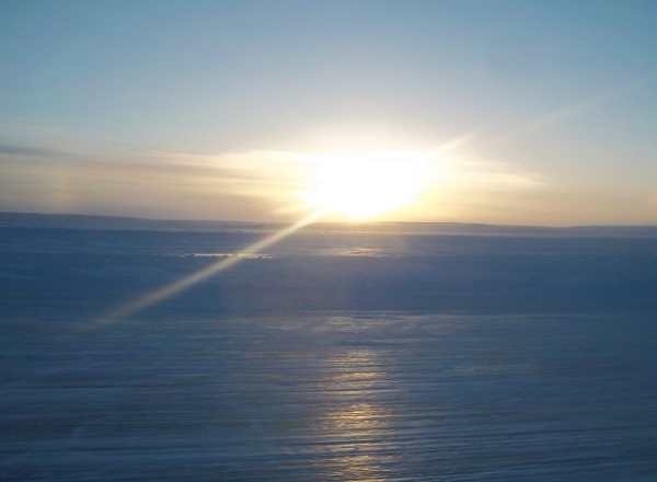 Sunrises, sunsets, sun dogs, Northern Lights and skies. Late afternoon sun on the ice roads with a slight Sun Dog.