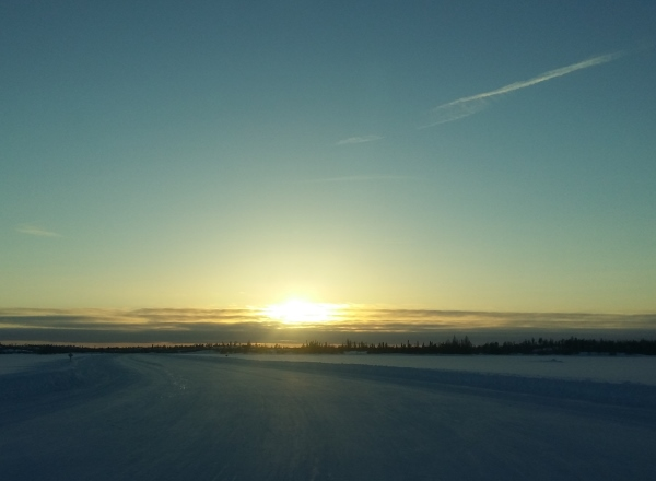 Sunrises, sunsets, sun dogs, Northern Lights and skies. Approaching the end of the lake with a beautiful setting sun.