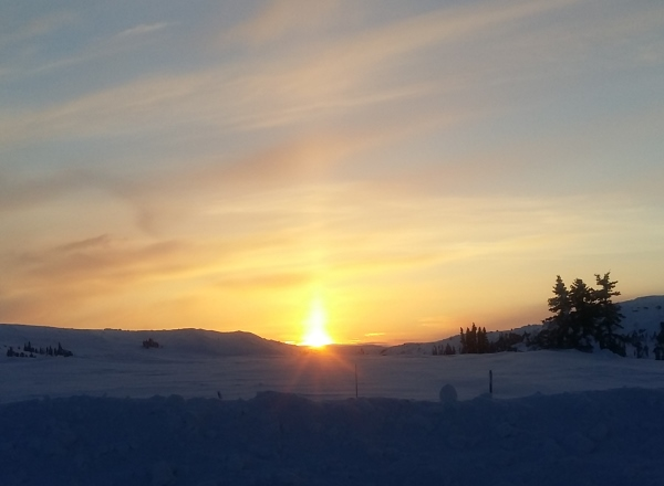 Sunrises, sunsets, sun dogs, Northern Lights and skies. Catching a pretty sunset near Snap Lake Diamond mine on the ice roads of Northern Canada.