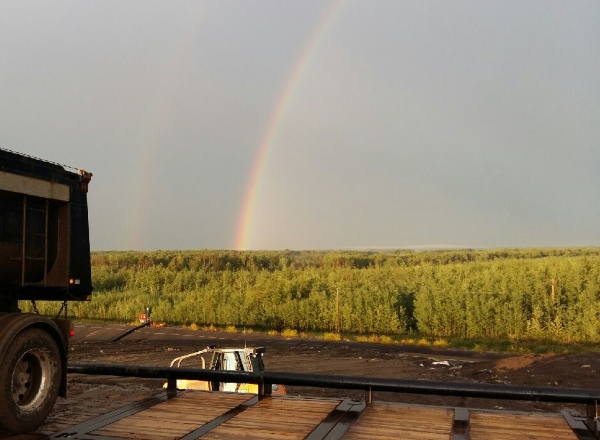 Sunrises, sunsets, sun dogs, Northern Lights and skies. a prominent rainbow in the oilfields of Northern Alberta.