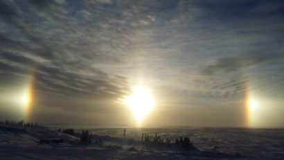 Sunrises, sunsets, sun dogs, Northern Lights and skies. Sun dog as seen from Lockhart Lake base camp on the ice roads.