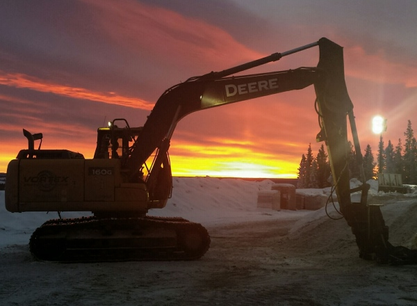 Sunrises, sunsets, sun dogs, Northern Lights and skies. Beautiful sunset seen from a drilling rig in Northern Alberta.