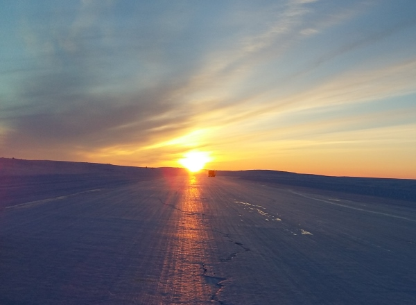 Sunrises, sunsets, sun dogs, Northern Lights and skies. Sub zero sunset shining its brilliance onto the ice roads.
