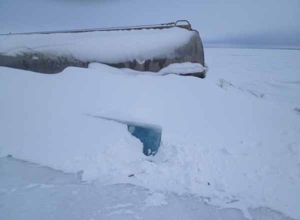Ice road accidents. A fuel tanker frozen in the middle of great bear lake after falling through the ice.
