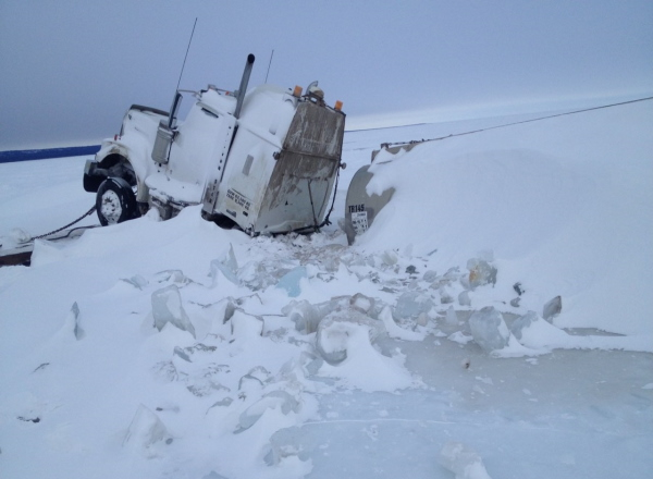 Fuel hauler with a very close call on Great Bear Lake Northwest Territories, Canada as the trailer falls through the ice and the tractor hangs on.